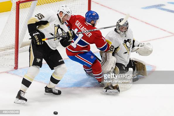 Sergei Gonchar of the Pittsburgh Penguins tries to defend against Brendan Gallagher of the Montreal Canadiens near goaltender MarcAndre Fleury during...