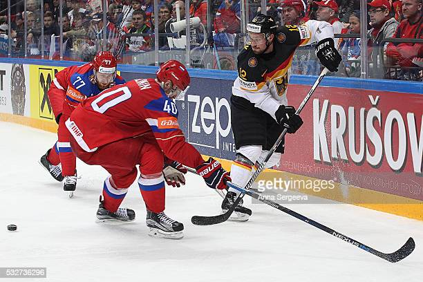 Sergei Kalinin of Russia and Brooks Macek of Germany battle for the puck at Ice Palace on May 19 2016 in Moscow Russia