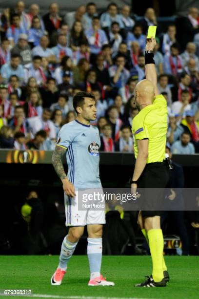 Sergei Karasev shows yellow card to Hugo Mallo defender of Celta de Vigo during the UEFA Europe League Round of 2 first leg match between Celta de...