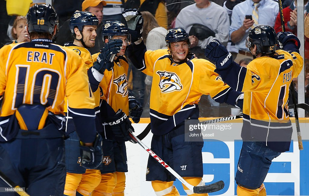 Sergei Kostitsyn #74 celebrates his goal with Mike Fisher #12, Shea Weber #6 and Roman Josi #59 of the Nashville Predators against the Edmonton Oilers during an NHL game at the Bridgestone Arena on March 25, 2013 in Nashville, Tennessee.
