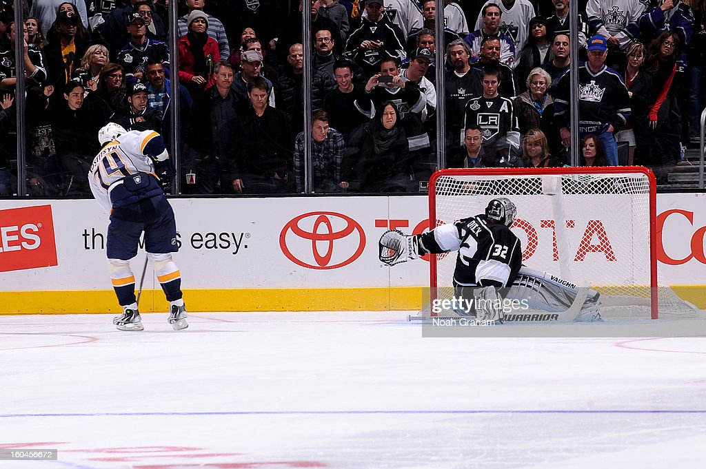 <a gi-track='captionPersonalityLinkClicked' href=/galleries/search?phrase=Sergei+Kostitsyn&family=editorial&specificpeople=599906 ng-click='$event.stopPropagation()'>Sergei Kostitsyn</a> #74 of the Nashville Predators shoots and scores the game winning goal in the shoot out against <a gi-track='captionPersonalityLinkClicked' href=/galleries/search?phrase=Jonathan+Quick&family=editorial&specificpeople=2271852 ng-click='$event.stopPropagation()'>Jonathan Quick</a> #32 of the Los Angeles Kings at Staples Center on January 31, 2013 in Los Angeles, California.