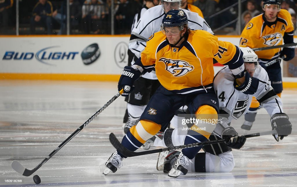 <a gi-track='captionPersonalityLinkClicked' href=/galleries/search?phrase=Sergei+Kostitsyn&family=editorial&specificpeople=599906 ng-click='$event.stopPropagation()'>Sergei Kostitsyn</a> #74 of the Nashville Predators skates around Justin Williams #14 of the Los Angeles Kings during an NHL game at the Bridgestone Arena on February 7, 2013 in Nashville, Tennessee.