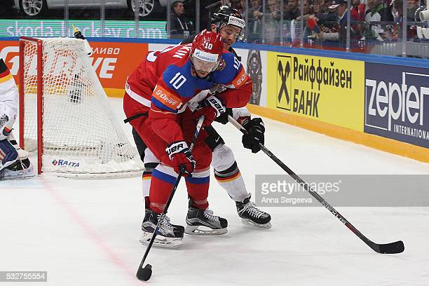 Sergei Mozyakin of Russia battles for the puck with Moritz Muller of Germany at Ice Palace on May 19 2016 in Moscow Russia Russia defeated Germany 41