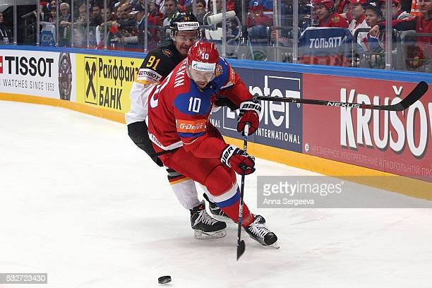 Sergei Mozyakin of Russia plays the puck against Moritz Muller of Germany at Ice Palace on May 19 2016 in Moscow Russia