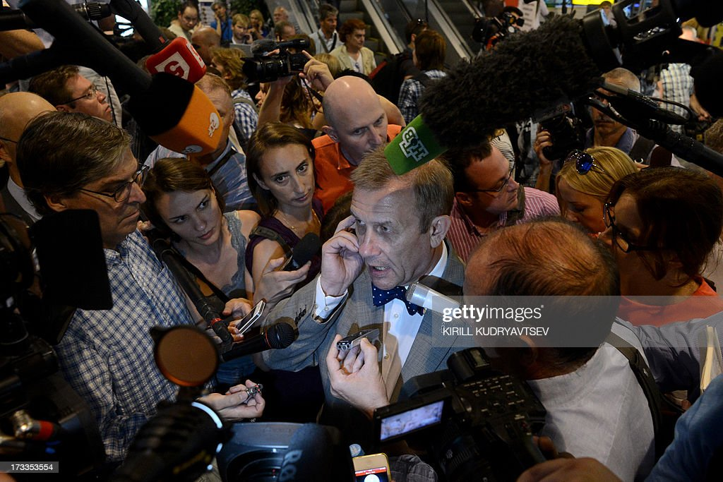 Sergei Nikitin, Director of Amnesty International's Moscow Office speaks with journalists before a meeting with US National Security Agency (NSA) fugitive leaker Edward Snowden inside the terminal F of Moscow's Sheremetyevo airport, on July 12, 2013, where Snowden reportedly remains without making any contact with the swarm of international reporters at the scene. Snowden told today a group of activists in a meeting at a Moscow airport that he wanted to claim asylum in Russia because he is unable to fly on anywhere else.