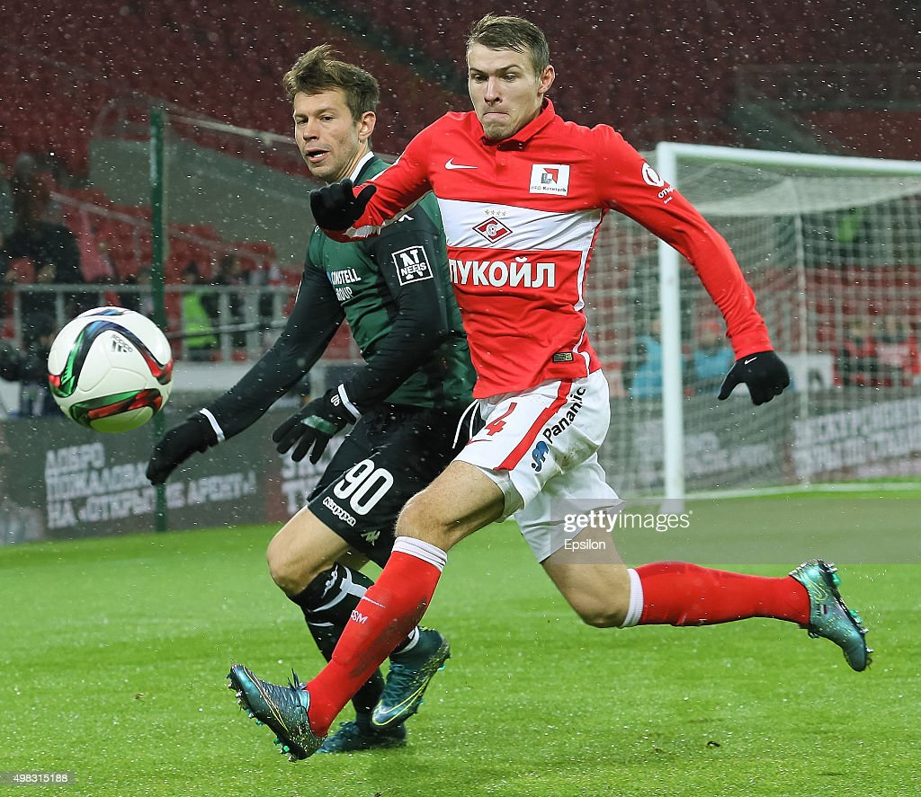 Sergei Parshivlyuk of FC Spartak Moscow challenged by <a gi-track='captionPersonalityLinkClicked' href=/galleries/search?phrase=Fyodor+Smolov&family=editorial&specificpeople=4277688 ng-click='$event.stopPropagation()'>Fyodor Smolov</a> of FC Krasnodar during the Russian Premier League match between FC Spartak Moscow v FC Krasnodar at Otkrytie Arena Stadium on November 22, 2015 in Moscow, Russia.