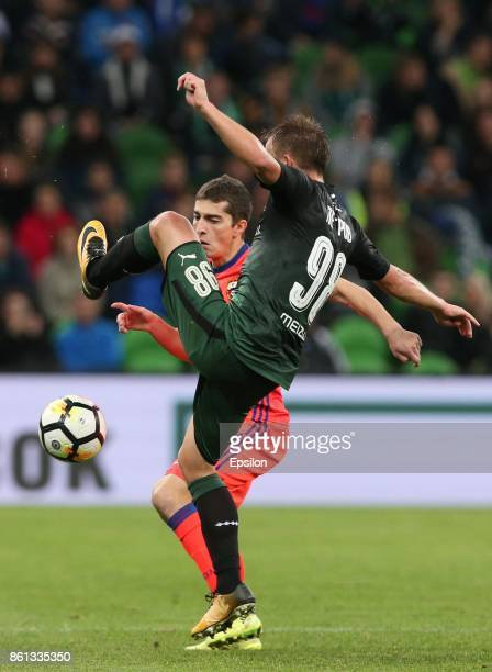 Sergei Petrov of FC Krasnodar is challenged by Astemir Gordyushenko of FC CSKA Moscow during the Russian Premier League match between FC Krasnodar v...