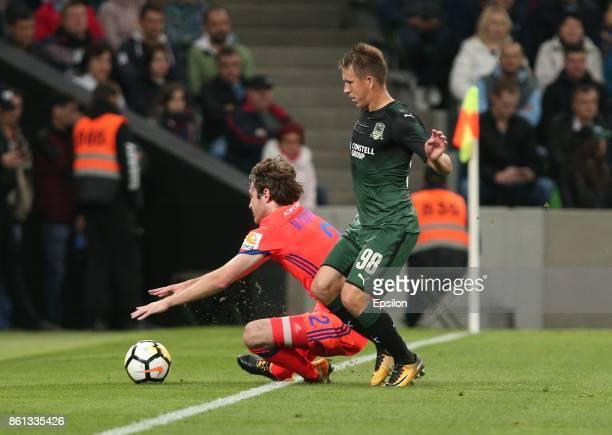Sergei Petrov of FC Krasnodar is challenged by Mario Fernandes of FC CSKA Moscow during the Russian Premier League match between FC Krasnodar v FC...