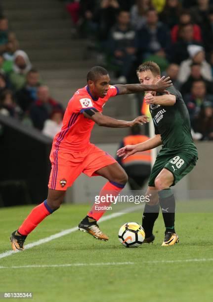 Sergei Petrov of FC Krasnodar is challenged by Vitinho of FC CSKA Moscow during the Russian Premier League match between FC Krasnodar v FC CSKA...