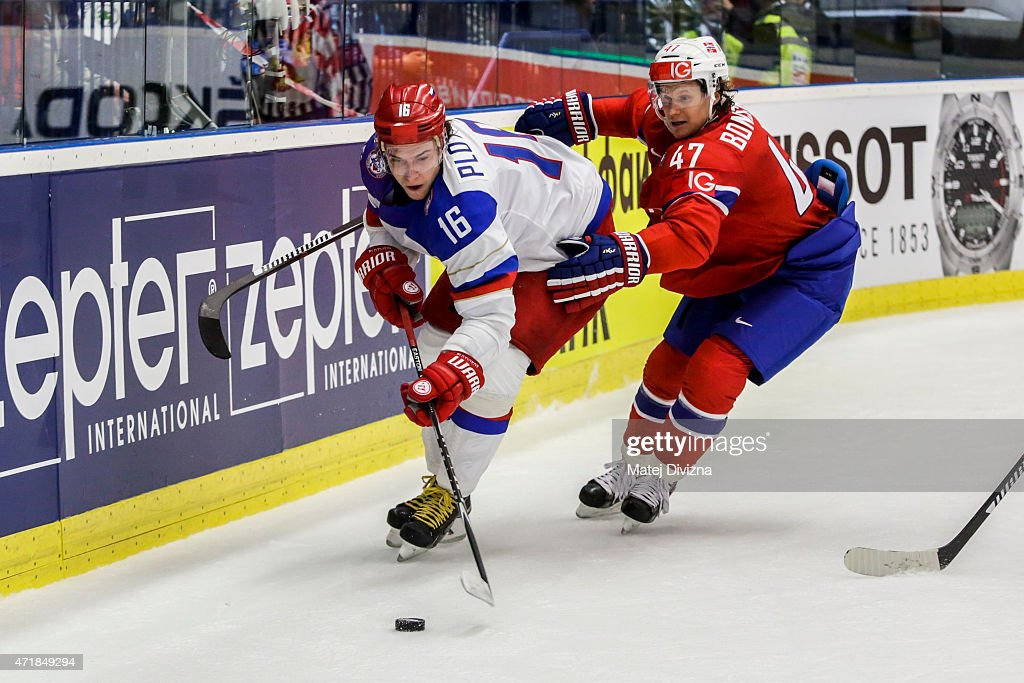 Sergei Plotnikov (L) of Russia and <a gi-track='captionPersonalityLinkClicked' href=/galleries/search?phrase=Alexander+Bonsaksen&family=editorial&specificpeople=6744709 ng-click='$event.stopPropagation()'>Alexander Bonsaksen</a> (R) of Norway battle for the puck during the IIHF World Championship group B match between Russia and Norway at CEZ Arena on May 1, 2015 in Ostrava, Czech Republic.