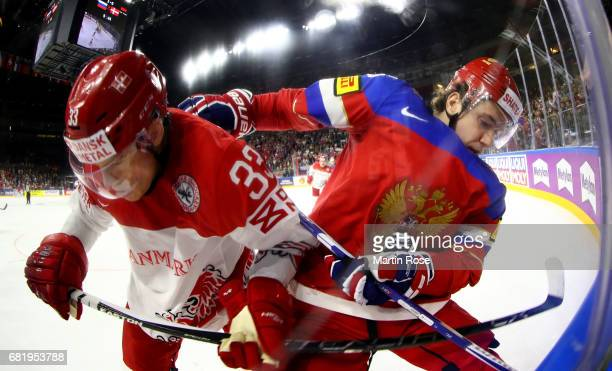Sergei Plotnikov of Russia challenges Julian Jakobsen of Denmark during the 2017 IIHF Ice Hockey World Championship game between Russia and Denmark...