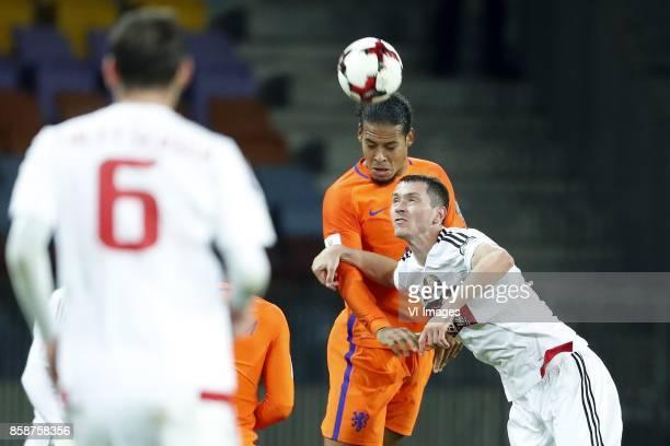 Sergei Politevich of Belarus Virgil van Dijk of Holland Nikolai Signevich of Belarus during the FIFA World Cup 2018 qualifying match between Belarus...