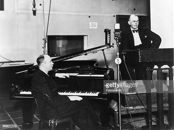 Sergei Prokofiev seated in front of a piano in a recording studio in Prague circa 1940s