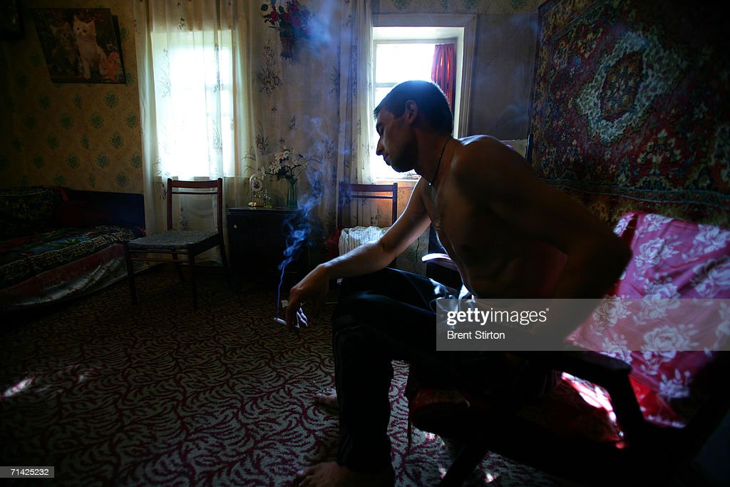 Sergei, 28, relaxes after shooting up in his groin with a local poppy-seed derived drug with a street name of Shiva on August 17, 2005 in Donetsk, Ukraine. Sergei has spent 5 years in prison for drug use and claims to be only an occasional user. He has been using since his father died. Sergei says that life does not offer him a better alternative so to get high is fine with him. Sergei's mother says that he uses everyday in the summer and less in winter. She lost her job 17 years ago when the local wine press closed and she has been unable to find work since. Sergei's dealings help her with financial support. Getty Images is partnering with the Global Business Coalition on HIV/AIDS ongoing projects.