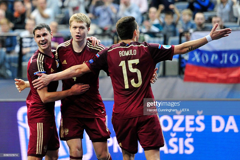 Sergei Sergeev, Dmitri Lyskov, Romulo of Russia celebrate their team second goal during the UEFA Futsal EURO 2016 quarter final match between Russia and Azerbaijan at Arena Belgrade on February 9, 2016 in Belgrade, Serbia.