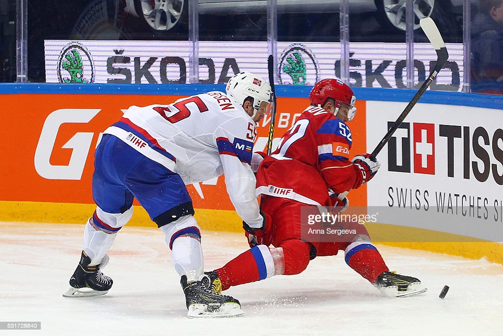 <a gi-track='captionPersonalityLinkClicked' href=/galleries/search?phrase=Sergei+Shirokov&family=editorial&specificpeople=723579 ng-click='$event.stopPropagation()'>Sergei Shirokov</a> #52 of Russia plays the puck against <a gi-track='captionPersonalityLinkClicked' href=/galleries/search?phrase=Ole-Kristian+Tollefsen&family=editorial&specificpeople=2129687 ng-click='$event.stopPropagation()'>Ole-Kristian Tollefsen</a> #55 of Norway during the IIHF World Championship at the Ice Palace on May 16, 2016 in Moscow, Russia.