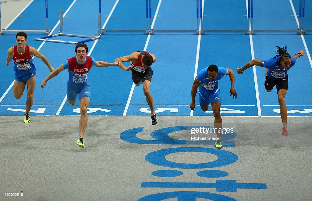 Sergei Shubenkov of Russia (2L) crosses the line first to win gold aheado of Paolo Dal Molin of Italy (2R) in the Men's 60m Hurdles Final during day one of the European Athletics Indoor Championships at Scandinavium on March 1, 2013 in Gothenburg, Sweden.