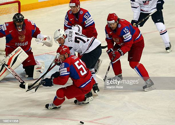 Sergei Soin of Russia and Paul Stastny of USA battle for the puck during the IIHF World Championship group H match between Russia and USA at Hartwall...