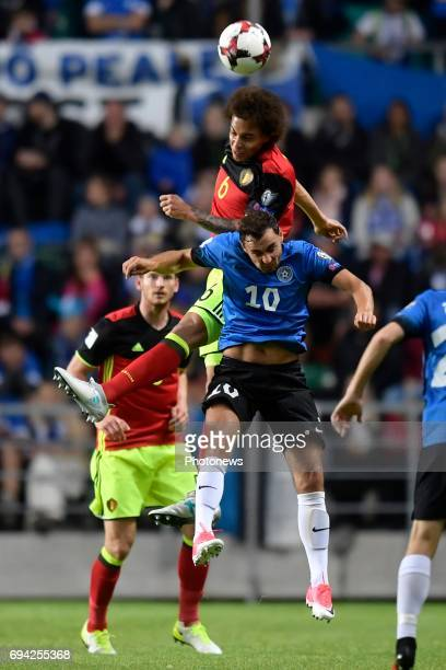 Sergei Zenjov defender of Estonia battles for the ball with Axel Witsel midfielder of Belgium during the World Cup Qualifier Group H match between...