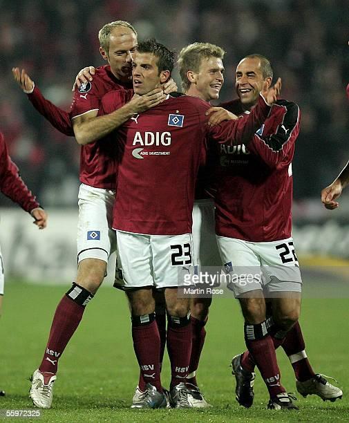 Sergej Barbarez Rafael van der Vaart Rene Klingbeil and Stefan Beinlich of Hamburg celebrate scoring the first goal during the UEFA Cup Group A match...