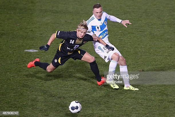 Sergej Kunst of the Balmain Tigers and Besart Berisha of the Melbourne Victory compete for the ball during a FFA Cup match between Balmain Tigers FC...