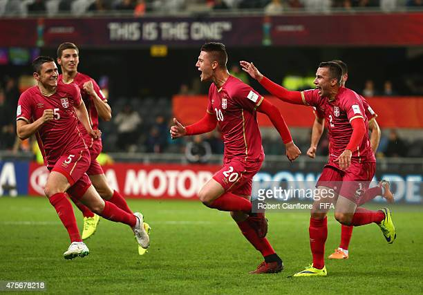 Sergej Milinkovic of Serbia celebrates with team mates after scoring a goal during the FIFA U20 World Cup New Zealand 2015 Group D match between...