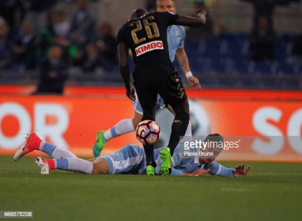 Sergej Milinkovic of SS Lazio and Kalidou Koulibaly of SSCNapoli fight for the ball during the Serie A match between SS Lazio and SSC Napoli at...