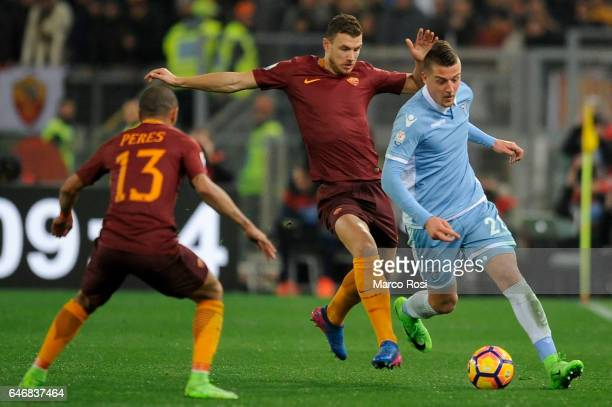 Sergej Milinkovic of SS Lazio compete for the ball with Edin Dzeko of AS Roma during the TIM Cup match between SS Lazio and AS Roma at Olimpico...