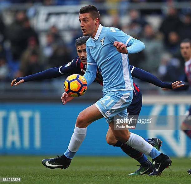 Sergej Milinkovic of SS Lazio competes for the ball with Adrian Stoian of FC Crotone during the Serie A match between SS Lazio and FC Crotone at...