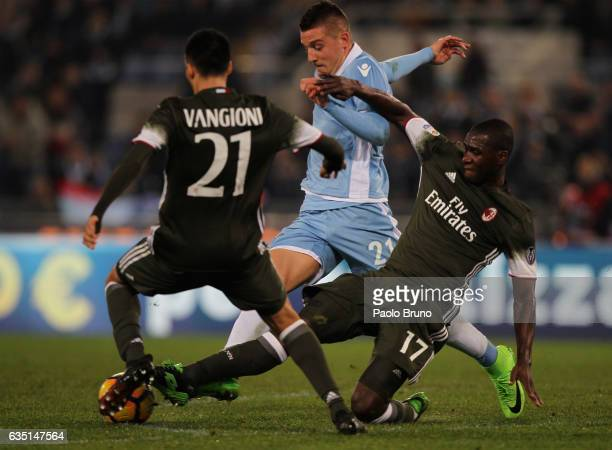 Sergej Milinkovic of SS Lazio competes for the ball with Cristian Zapata and Leonel Vangioni of AC Milan during the Serie A match between SS Lazio...