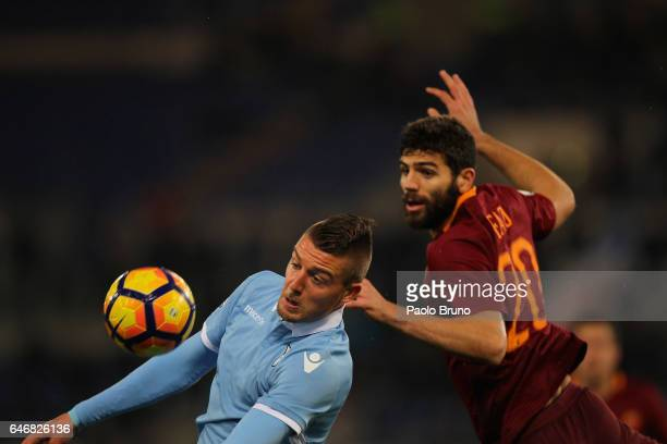 Sergej Milinkovic of SS Lazio competes for the ball with Federico Fazio of AS Roma during the TIM Cup match between SS Lazio and AS Roma at Olimpico...