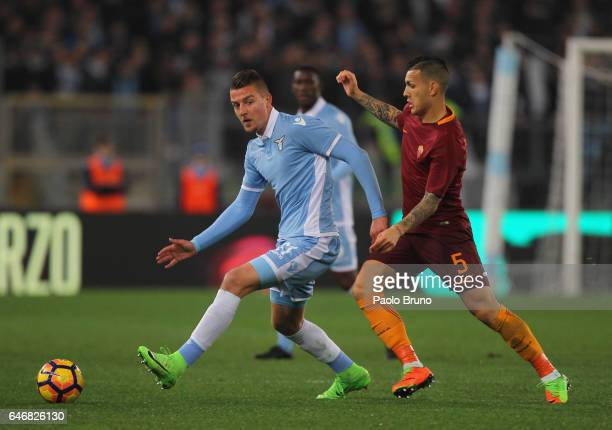 Sergej Milinkovic of SS Lazio competes for the ball with Leandro Paredes of AS Roma during the TIM Cup match between SS Lazio and AS Roma at Olimpico...