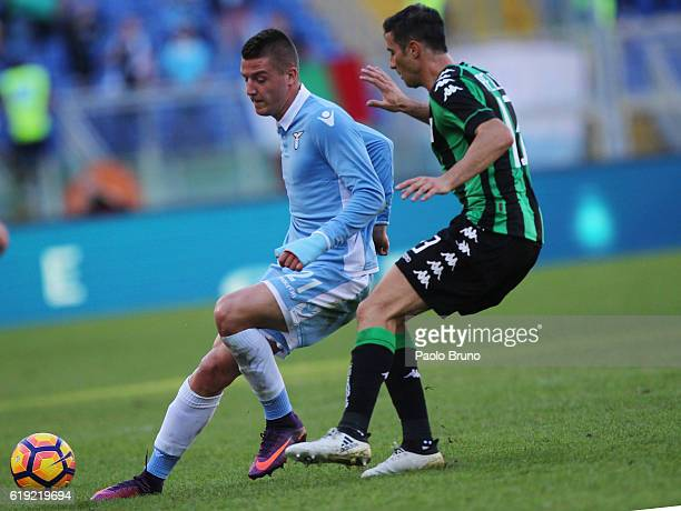 Sergej Milinkovic of SS Lazio competes for the ball with Lorenzo Pellegrini of US Sassuolo during the Serie A match between SS Lazio and US Sassuolo...