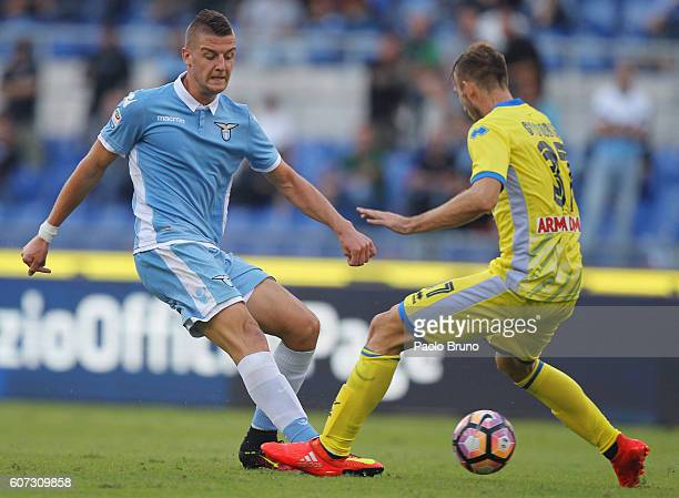 Sergej Milinkovic of SS Lazio competes for the ball with Norbert Gyomber of Pescara Calcio during the Serie A match between SS Lazio and Pescara...