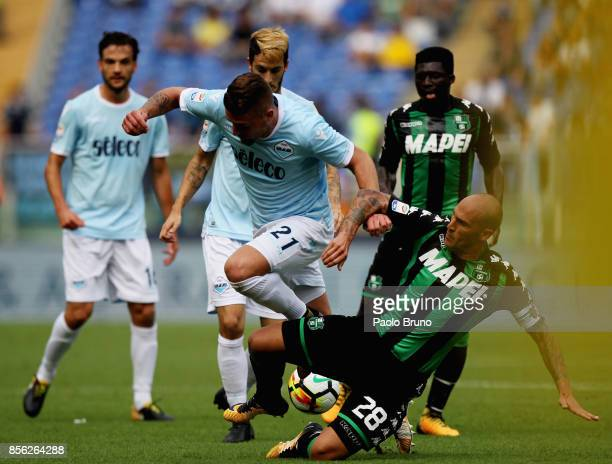 Sergej Milinkovic of SS Lazio competes for the ball with Paolo Cannavaro of US Sassuolo during the Serie A match between SS Lazio and US Sassuolo at...