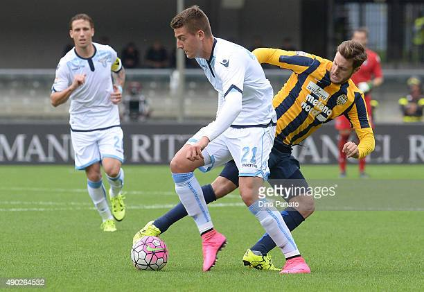 Sergej Milinkovic of SS Lazio competes with Jacopo Sala of Hellas Verona during the Serie A match between Hellas Verona FC and SS Lazio at Stadio...