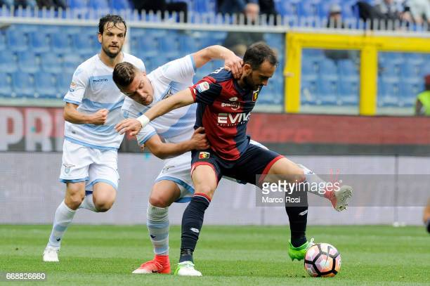 Sergej Milinkovic Savic of SS Lazio battles with Santiago Gentiletti of Genoa CFC during the Serie A match between Genoa CFC and SS Lazio at Stadio...