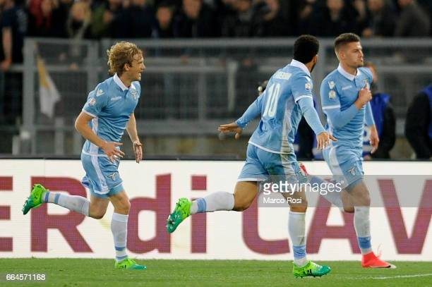 Sergej Milinkovic Savic of SS Lazio celebrates the opening goal with his team mates during the TIM Cup match between AS Roma and SS Lazio at Stadio...
