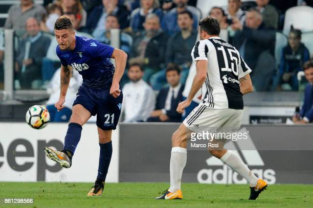 Sergej Milinkovic Savic of SS Lazio compete for the ball with Andrea Barzagli of Juventus during the Serie A match between Juventus and SS Lazio on...