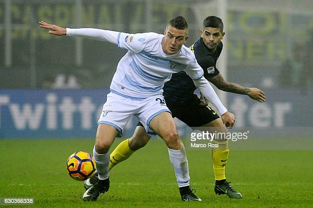 Sergej Milinkovic Savic of SS Lazio compete for the ball with Ever Banega of FC Internazionale during the Serie A match between FC Internazionale and...