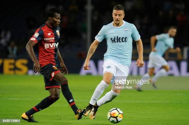 Sergej Milinkovic Savic of SS Lazio compete for the ball with Isac Cofie of Genoa CFC during the Serie A match between Genoa CFC and SS Lazio at...