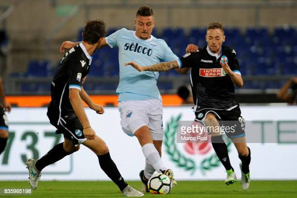 Sergej Milinkovic Savic of SS Lazio compete for the ball with Manuel Lazzari of Spal during the Serie A match between SS Lazio and Spal at Olimpico...