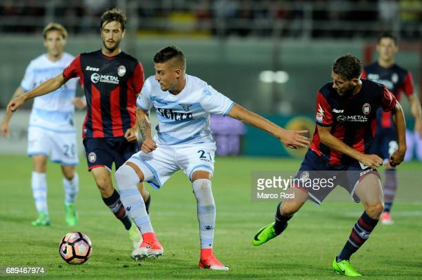 Sergej Milinkovic Savic of SS Lazio compete for the ball with Mario Sampirisi of FC Crotone during the Serie A match between FC Crotone and SS Lazio...