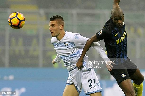 Sergej Milinkovic Savic of SS Lazio compete for the ball with Geoffrey Kondogbia of FC Internazionale during the Serie A match between FC...