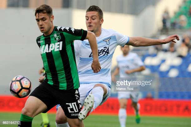 Sergej MIlinkovic Savic of SS Lazio compete for the ball with Pol Lirola of US Sassuola during the Serie A match between US Sassuolo and SS Lazio at...