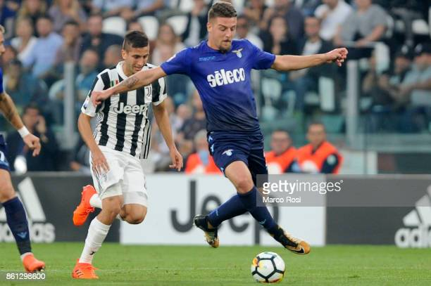 Sergej Milinkovic Savic of SS Lazio compete for the ball with Rodrigo Bentacur of Juventus during the Serie A match between Juventus and SS Lazio on...