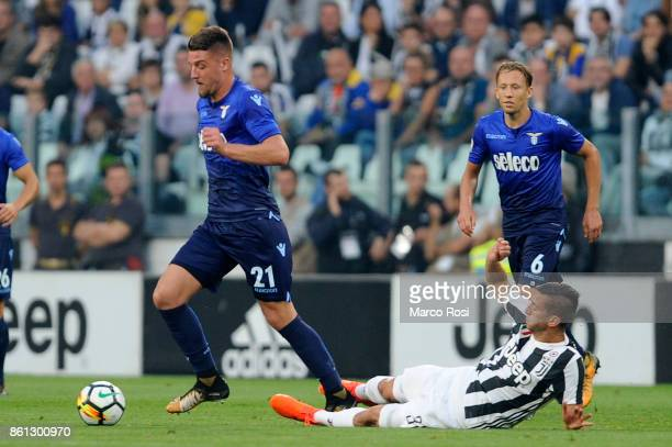 Sergej Milinkovic Savic of SS Lazio compete for the ball with Rodrigo Bentancur of Juventus during the Serie A match between Juventus and SS Lazio on...