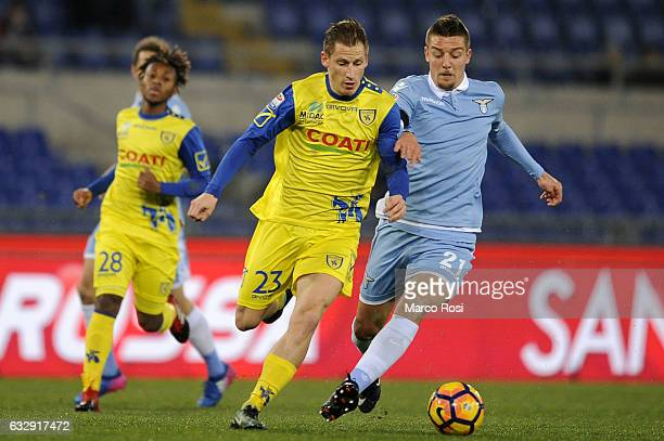 Sergej Milinkovic Savic of SS Lazio compete for the ball with Walter Birsa of AC Chievo Verona during the Serie A match between SS Lazio and AC...