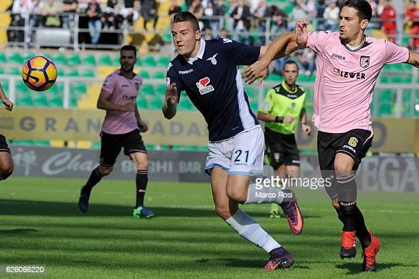 Sergej Milinkovic Savic of SS Lazio competes for the ball with Edoardo Goldaniga of US Citta di Palermo during the Serie A match between US Citta di...