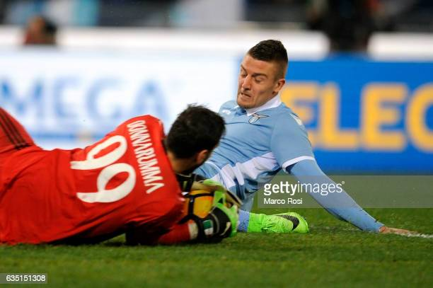 Sergej Milinkovic Savic of SS Lazio competes for the ball with Gianluigi Donnaruma of AC Milan during the Serie A match between SS Lazio and AC Milan...